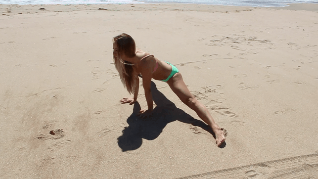 1. Slowly lower your body down into middle splits, by using your arms to support. 2. If this is too strenuous on your hips, then start in a seated straddle, and reach the arms forward instead. 2. Pull your lower abdominals in to help protect your lower back. Keep the spine straight and strong. 3. This stretch is difficult, so find peace through the use of your breath. Open your heart up to the new territory of space throughout your body. 4. If the sensations in your hips begin to give into the earth, let it go and deepen the stretch.